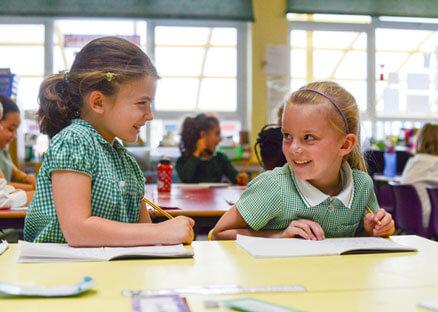 Smiley-girls-at-desk-438